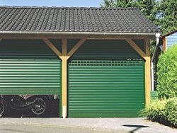 Pair of green Seceuroglide doors with vision slats and vented slats