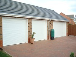 triple garage with insulated roller doors