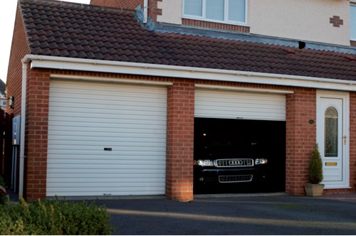 Gliderol Glide-Rol-a-Door installed on home with expensive Audi car in garage