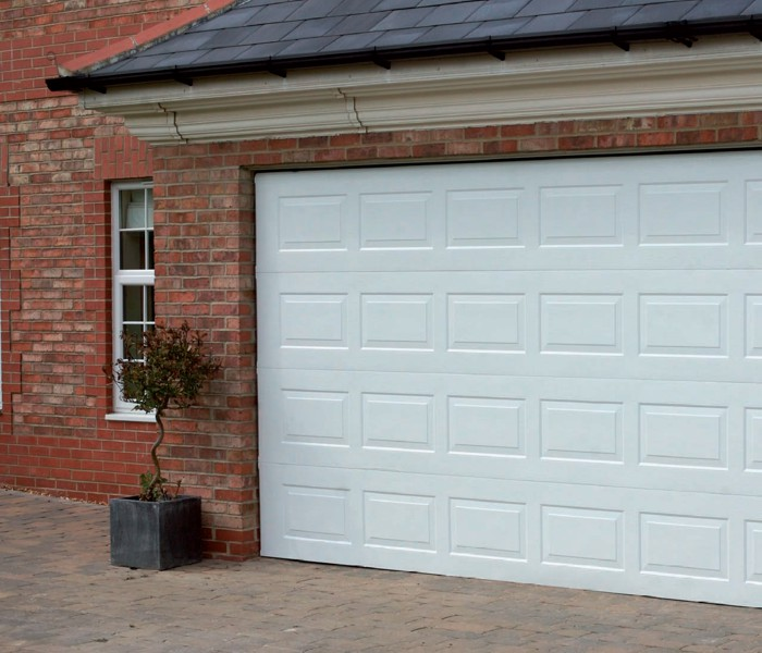 Gliderol Sectional Oxford Panelled Garage Door In White Installed On House