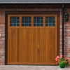 Hormann timber up and over garage door and electric operator promotion