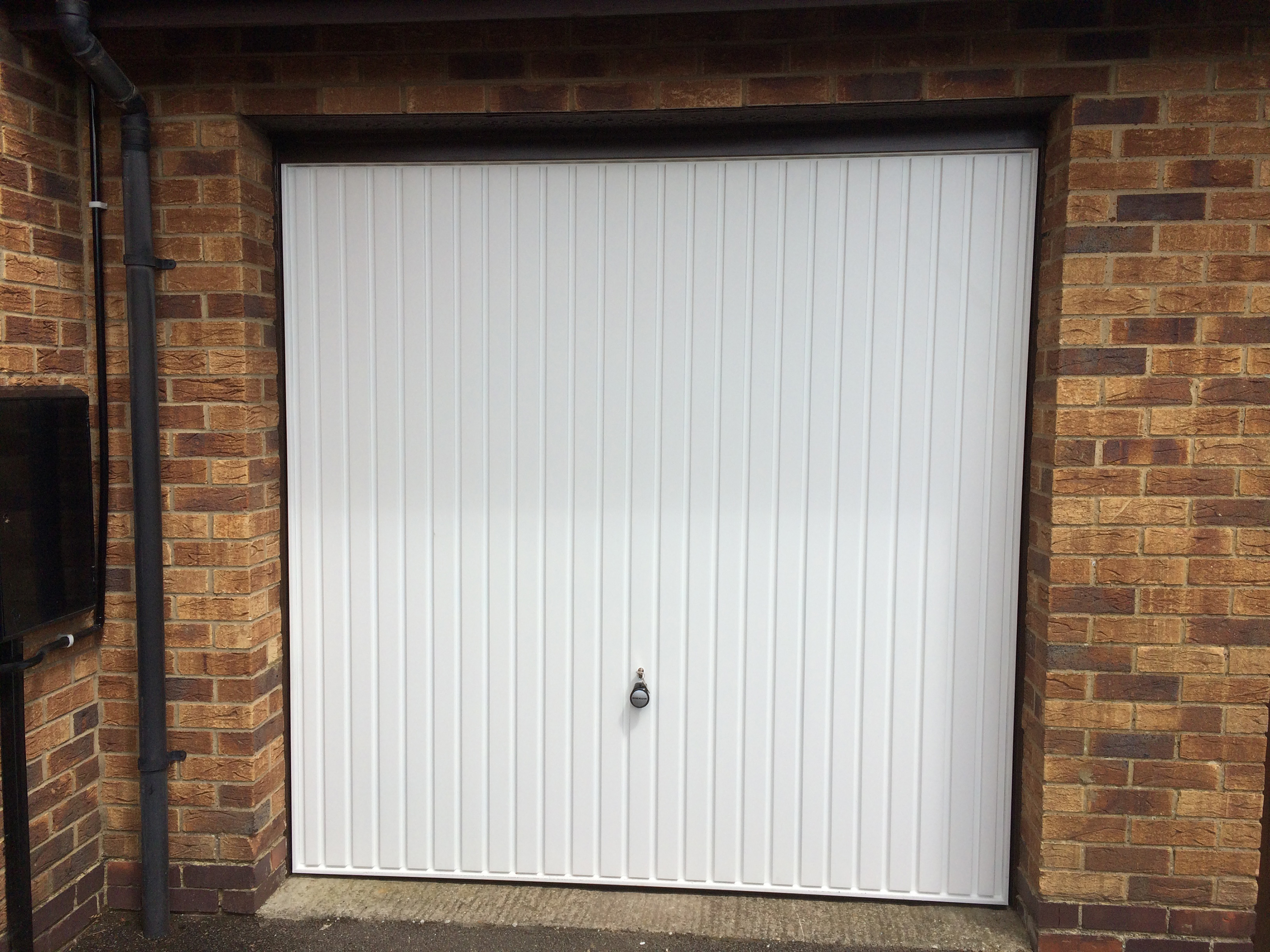 Hormann garage doors sectional garage doors online uk to the structural opening using the set of steel brackets supplied three down each side of the frame one at the head on larger sized doors 13ft rubansaba