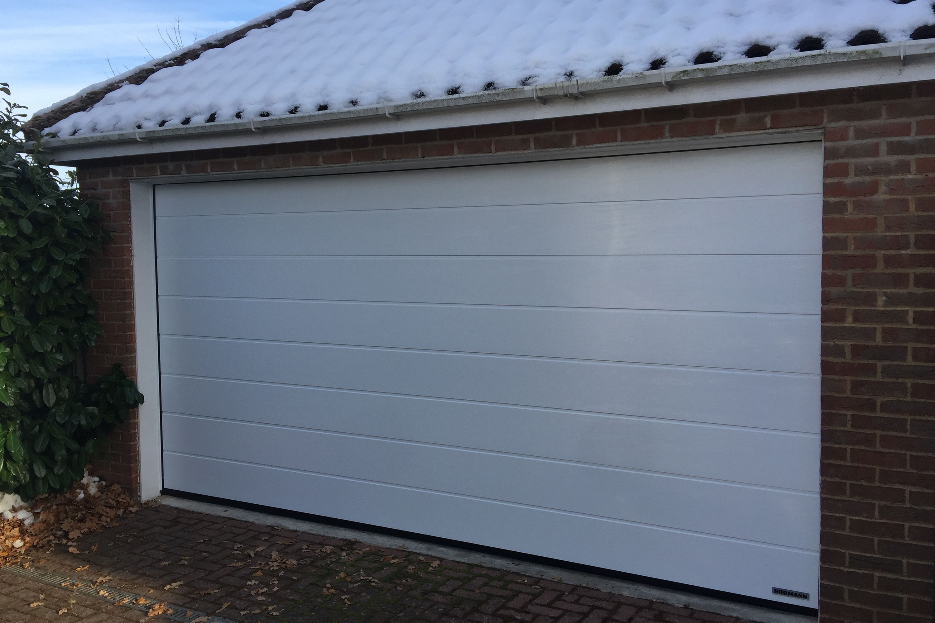 Hormann garage doors sectional garage doors online uk do be aware that if you have limited width you may not have enough drive through width especially on 7 feet wide 2134mm doors or narrower rubansaba