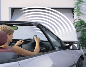 operator being used to open a remote controlled garage door