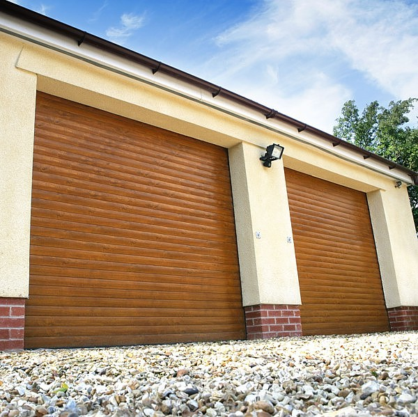 Golden Oak finish roller doors on a twin garage