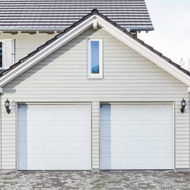 White Carteck sectional garage doors